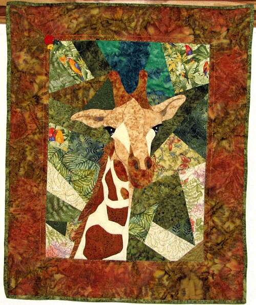 Giraffe Quilt 24 x 30 inch quilt created from a Malec Designs pattern. Sewn and quilted by Rita Meyerhoff.