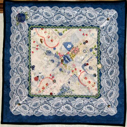 Hanky. Wall-hanging sized quilt (24 x 24 inchs) with hand and machine-sewn embellishments. Original copyrighted design by Rita Meyerhoff.