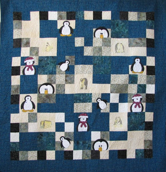 Penguin Quilt Created from a Frosty Friends Quilt by Joni Pike. This full size quilt was sewn and quilted by Rita Meyerhoff.