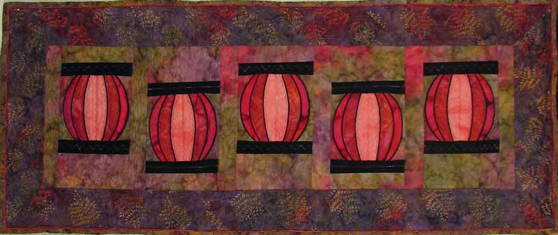 This 17 x 42.5 inch table runner created from Susan Cleveland's book Piping Hot Curves. Sewn and quilted by Rita Meyerhoff.
