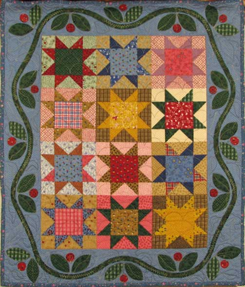 This 25 x 30 inch cheater cloth makes a nice centerpiece for your dining room table. Sewn and quilted by Rita Meyerhoff.