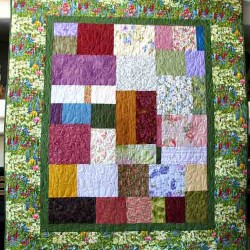 Full size scrap memory quilt in honor of Patti. Original copyrighted design by Rita